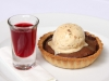 Warm Chocolate Tart with Raspberry Consume & Pistachio Ice Cream